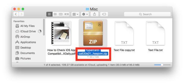 El estado de carga del archivo de iCloud Drive se muestra debajo de los íconos en el Finder